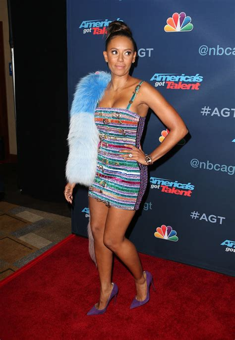 Mel Dress mel b flaunts serious cleavage as she pours