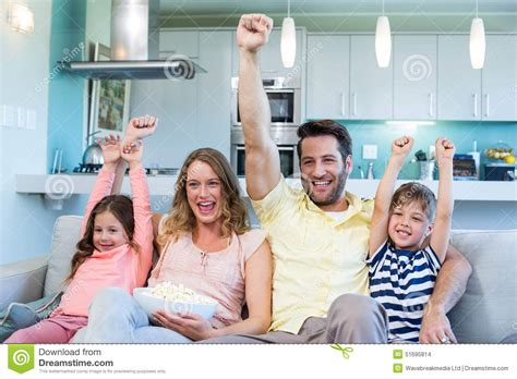 happy family on the tv stock photo image