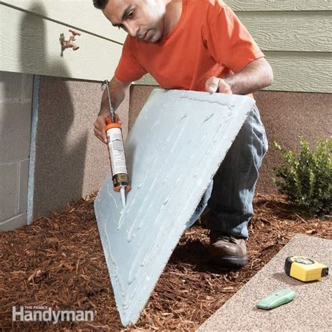 outside basement wall covering foundation insulation panels the family handyman