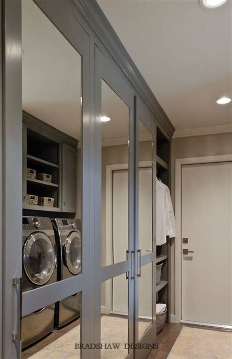 floor to ceiling storage cabinets with doors laundry room with floor to ceiling mirrored cabinets by