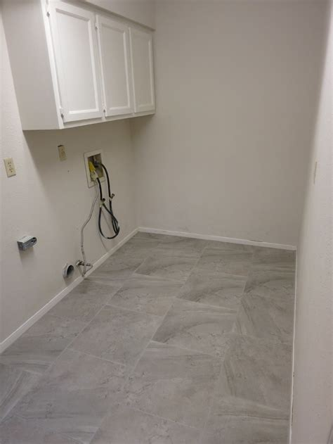laundry room flooring we officially a laundry room evan katelyn home diy tutorials