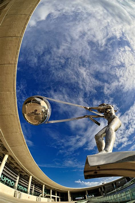 gravity defying sculpture  mother nature rotating earth