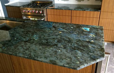 Granite Island Kitchen a knife with a handle made of the mineral labradorite pics