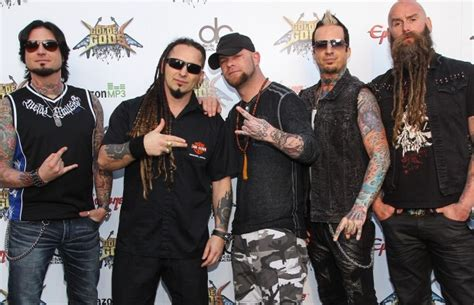 five finger death punch star sets up tattoo removal