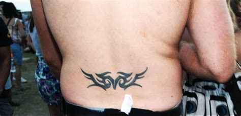 Lower Back Tattoos For Men Ideas And Designs For Guys Lower Back Word Tattoos