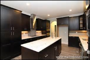 Better kitchen mixing dark kitchen cabinets with light granite