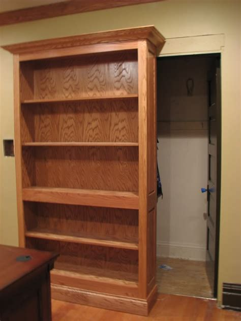 Secret Closet Doors by This Bookcase Slides To The Left To Reveal Closet Space