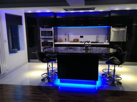dark kitchen cabinets and blue light floors with modern