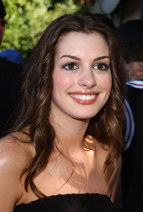 A fresh faced Anne Hathaway sported glossy lips at the