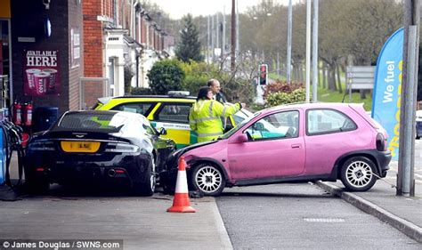 pink aston martin pink corsa crashes into black dbs 187 aston martin com