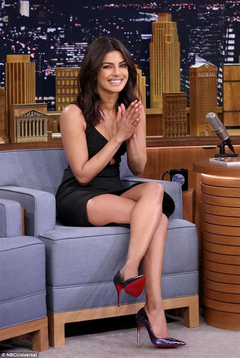 priyanka chopra shows off cleavage as she challenges jimmy