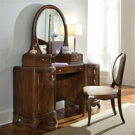wooden bedroom vanity furniture with large oval mirror