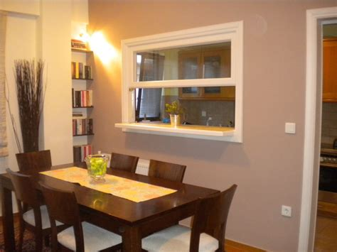 dining room with window to the kitchen