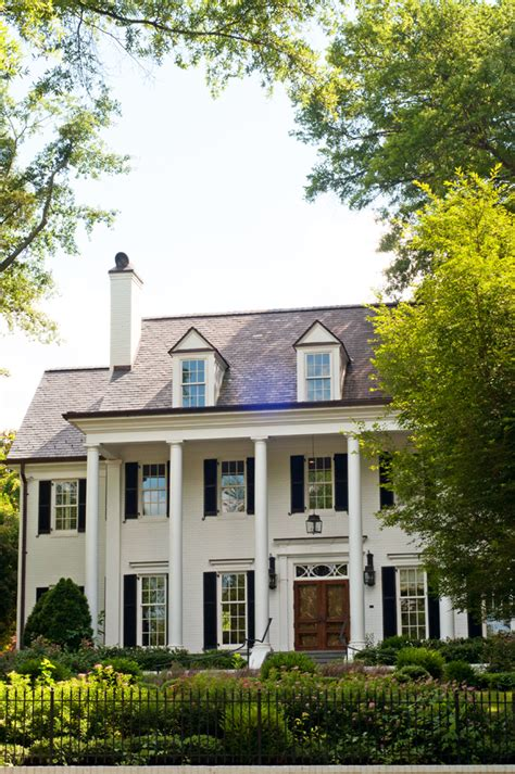 white colonial homes white painted brick black shutters dormers lantern