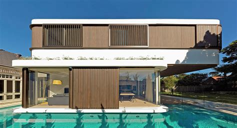 2 house with pool a modern house with a wraparound swimming pool design