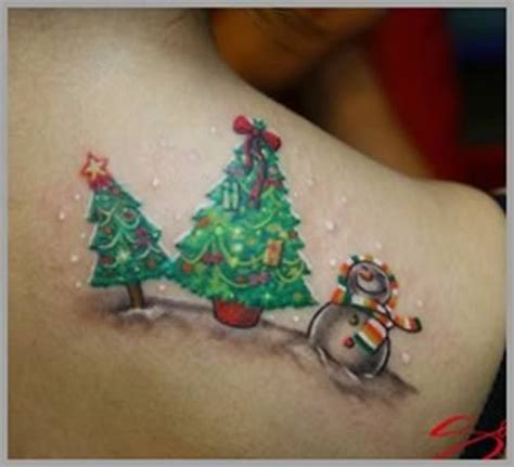 christmas tattoos 25 best ideas about on