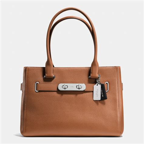 Coach Pabbled Leather Tote lyst coach swagger pebbled leather tote in brown
