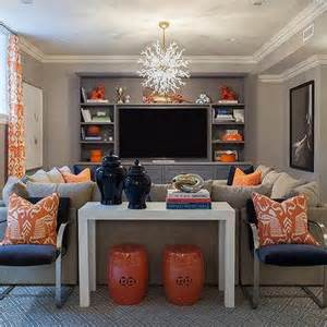 blue and orange living room with built in media unit contemporary living room