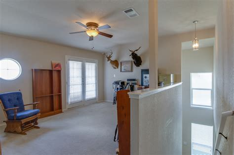 girls room that have a office up stairs upstairs office game room viewed from stairwell the