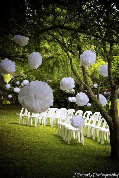 Floating pompom decorations garden wedding   wedding