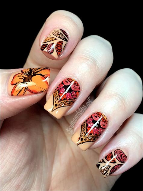 uber chic nail art tutorial i used uber chic beauty plate 1 02 for the tiger lilly on