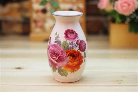 thriving flowers ceramic vasewatzin
