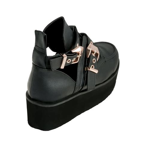 black leather flatform cut out boots from parisia
