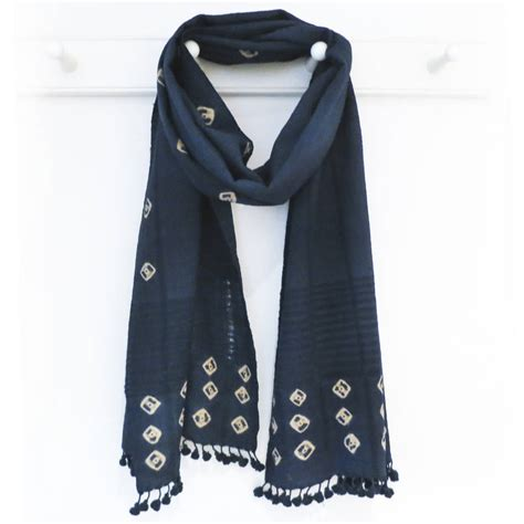 petrol blue artisan wool scarf with bobble fringe by