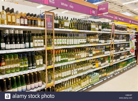 Shelf Shopping by White Wine On Shelves In The Licence Department Of A