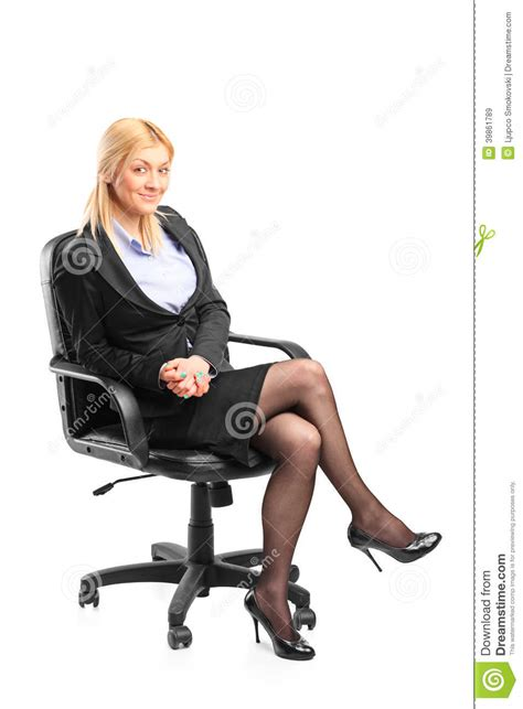 White Sitting Chair Blond Businesswoman Sitting In An Office Chair Stock Photo