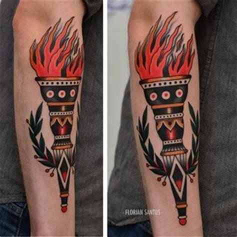 traditional torch tattoo instagram post by florian santus floriansantus