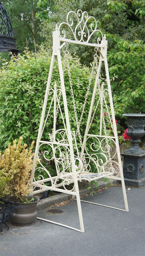 swinging garden seat garden swings the enchanting element in your backyard