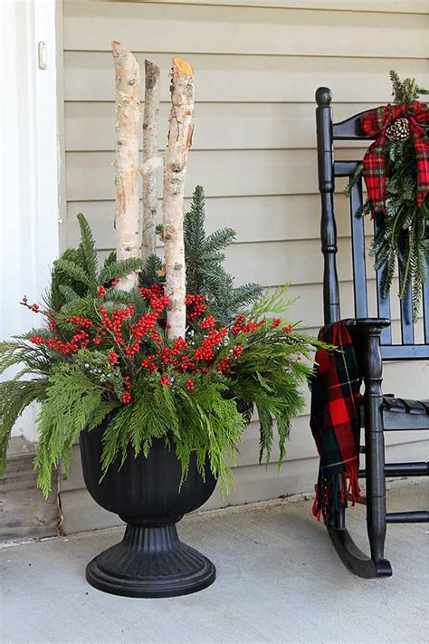 christmas decorating huge stone urns in front of entrance how to make outdoor planters house of hawthornes