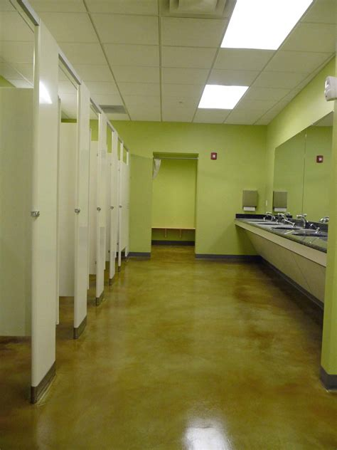 light green epoxy painting concrete floors in bathroom combined with white interior color decor