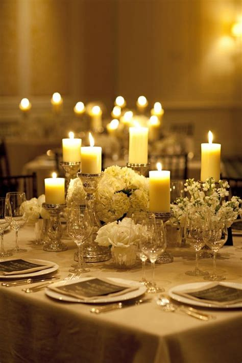 table centerpieces with candles each 8 foot table will a cluster of of silver mercury