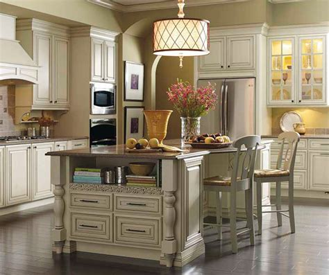 cream glazed kitchen cabinets cream cabinets with glaze kemper cabinetry