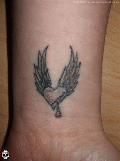male heart tattoo designs wings wrist fresh ideas
