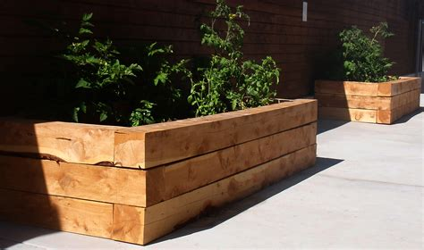 How To Build A Raised Vegetable Garden With Landscape Timbers
