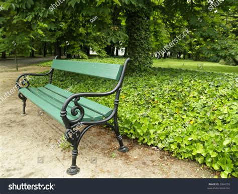 small park bench small green bench in park on poland stock photo 5964259