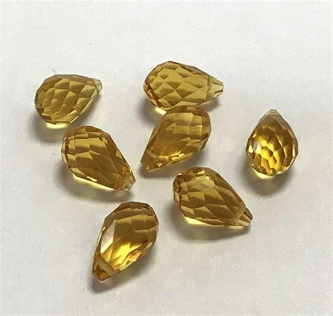 dollar bead 8 x 13mm briolette topaz 7 qty