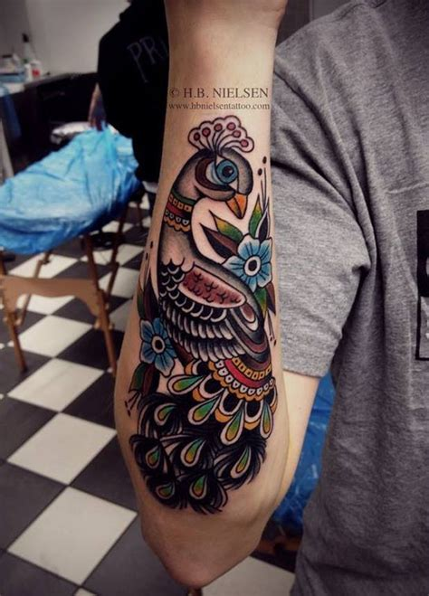 old school tattoo watercolor old school style peacock watercolor tattoo on forearm