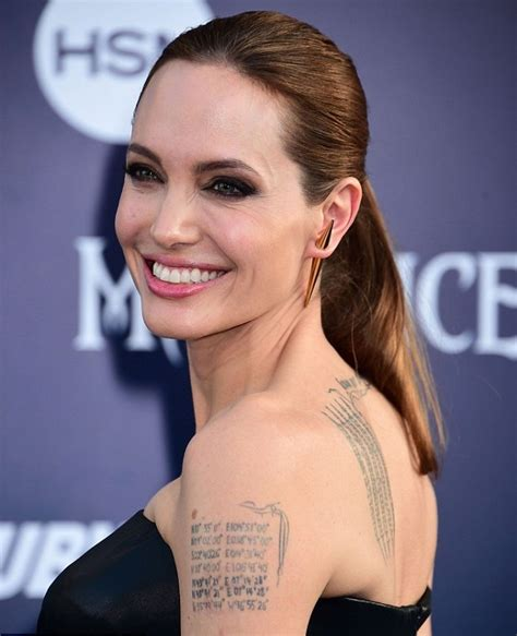 sacred fearless angelina jolie tattoo designs amp meanings