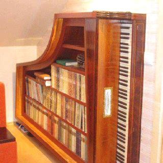 recycle a baby grand piano into a bookcase cool idea