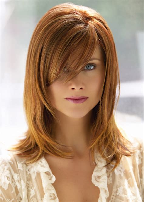 mid length hair cuts longer in front more layered medium length hairstyle with side swept long