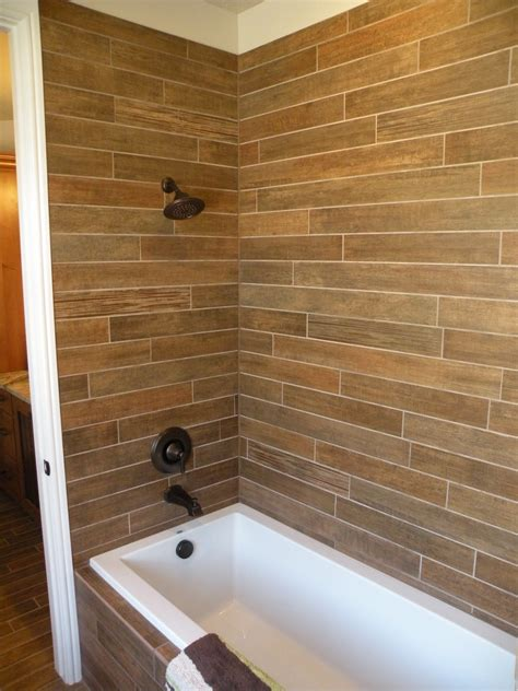 Wood Tile Bathroom World Imports Wood Look Tile Spa Shower Www Oldworldstoneimports World