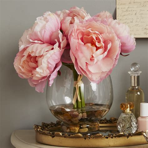 peonies in vase lcgflorals peonies in a glass vase with river rocks and