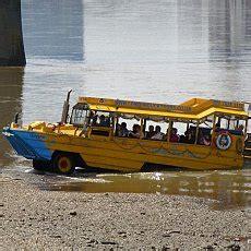 river thames yellow bus london eye river cruises on the thames
