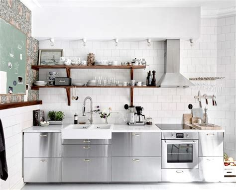Cover panels utilize brass hardware on stainless steel cabinets for a