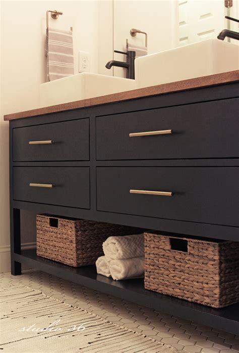 black vanity natural wood top open shelf bronze
