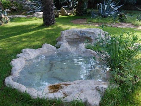 giardini con laghetti artificiali fontana in pietra ricostruita con cascata laghetti